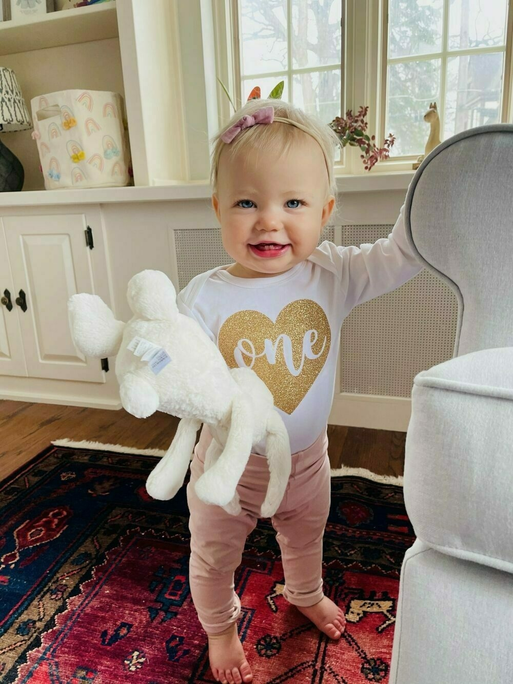 My one-year old daughter in her birthday shirt