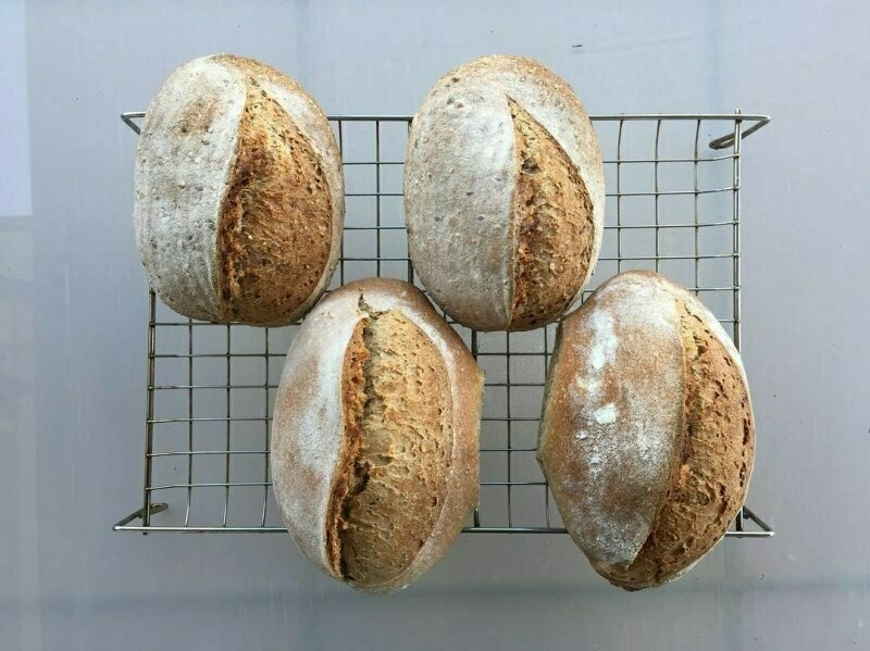 I appreciate fancy scoring when I see it, but there is also something marvellous about a loaf that so clearly reprises the seeds it came from.